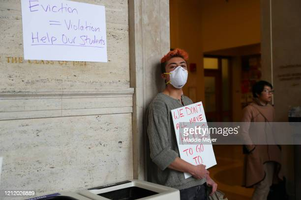 Graduate student Aubrey Simonson protests inside Building 10 on the campus of Massachusetts Institute of Technology on March 12 2020 in Cambridge...