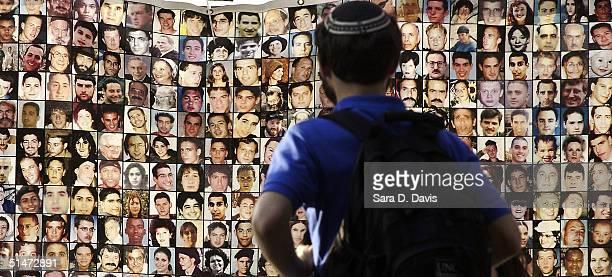 Graduate student Jonas Rosenbloom 27, looks at faces of Israelis killed by suicide bombings on display at Duke University on October 12, 2004 in...