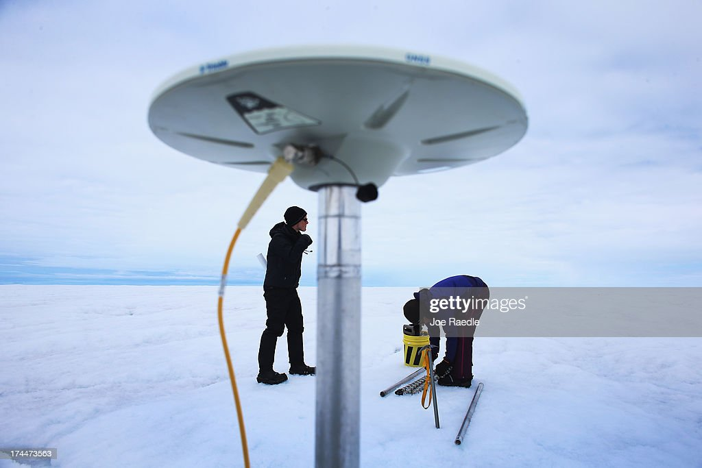 Graduate Student, Laura Stevens, (L) from the Massachusetts Institute of Technology and Woods Hole Oceanographic Institution and Sarah Das from the Woods Hole Oceanographic Institution place a GPS unit into the ice on July 16, 2013 on the Glacial Ice Sheet, Greenland. Their research is part of a team of scientists that is using Global Positioning System sensors to closely monitor the evolution of the surface lakes and the motion of the surrounding ice sheet. As the sea levels around the globe rise, researchers affilitated with the National Science Foundation and other organizations are studying the phenomena of the melting glaciers and its long-term ramifications. The warmer temperatures that have had an effect on the glaciers in Greenland also have altered the ways in which the local populace farm, fish, hunt and even travel across land. In recent years, sea level rise in places such as Miami Beach has led to increased street flooding and prompted leaders such as New York City Mayor Michael Bloomberg to propose a $19.5 billion plan to boost the citys capacity to withstand future extreme weather events by, among other things, devising mechanisms to withstand flooding.