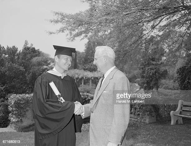Graduate Student Shaking Hands With Senior Man