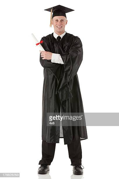 graduate student with diploma - graduation clothing stock pictures, royalty-free photos & images