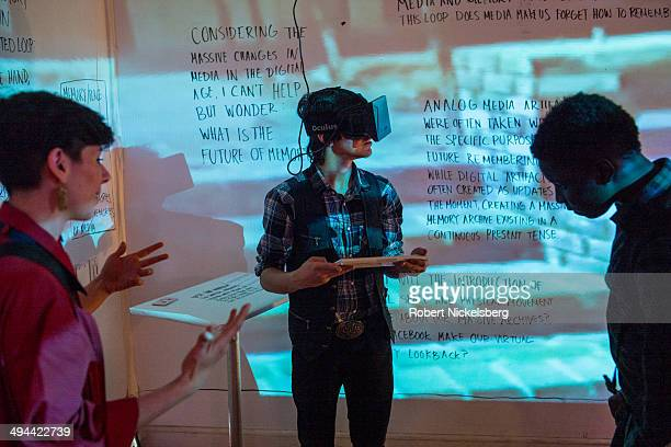 Graduate students enrolled at New York University's Interactive Telecommunications Program exhibit their Oculus Rift project May 20 2014 in New York...