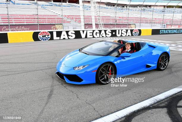 Graduate takes a victory lap in a Lamborghini after receiving his diploma during a commencement ceremony for Faith Lutheran High School held at Las...
