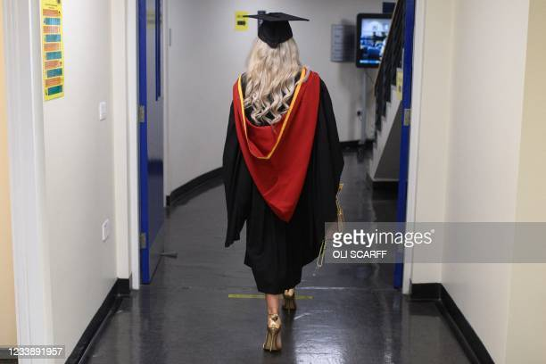 Graduate walks on campus at the University of Bolton to receive her degree certificates in a Covid-safe, in-person graduation ceremony one of a...