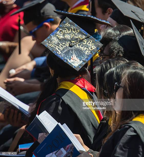 A graduate wearing graduation cap with message is seen during University of Pennsylvania 260th Commencement Ceremony at Franklin Field at the...