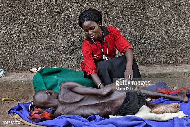 graduated Clinical Officer Janet Mandera 25yearsold from Magui County treats a woman that suffer from malnutrition at the AMREF managed PHCC on...