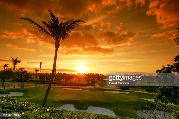 Graduated colour filter used on this image; The sun rises over the seventh green at Seminole Golf Club on November 29, 2004 in Juno Beach, Florida.