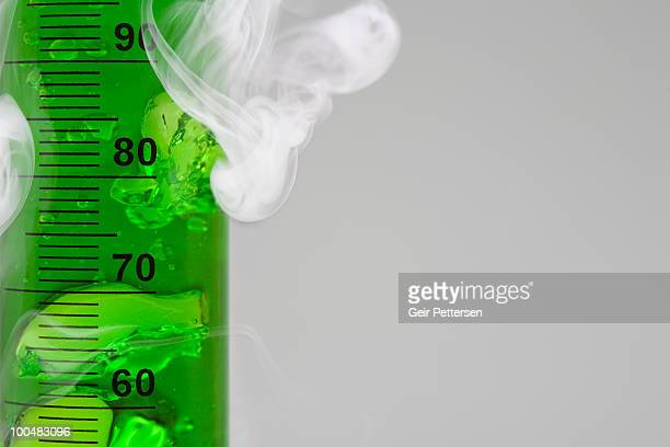 Graduated cylinder with bubbling green liquid