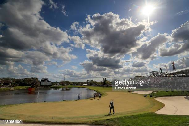 Graduated neutral density filter used on this image; Francesco Molinari celebrates holing a long putt for birdie on the par 4, 18th hole as his...