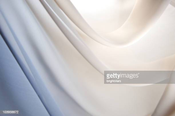 graduated silk from blue to white - white satin stock photos and pictures