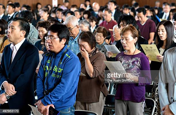 Graduates and students sing their school song during the farewell ceremony on October 10 2015 in Natori Japan The school buildings of former Yuriage...
