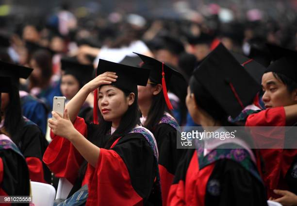 Graduates attend the graduation ceremony of Wuhan University on June 22 2018 in Wuhan Hubei Province of China Over 15000 undergraduates master and...