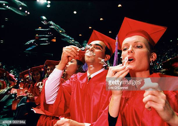 Graduates Blowing Bubbles