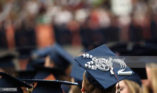 A graduate's cap is seen with the year '2012' during the 2012 Syracuse University Commencement at Syracuse University on May 13 2012 at the Carrier...