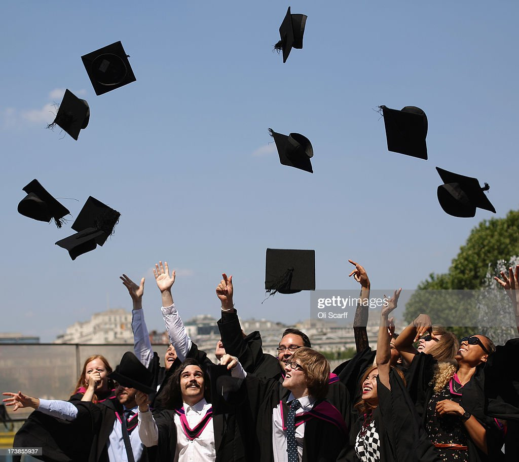 Graduates celebrate after leaving their graduation ceremony at the Royal Festival Hall on the Southbank in high temperatures on July 18, 2013 in London, England. The United Kingdom is experiencing a second week of heatwave conditions.