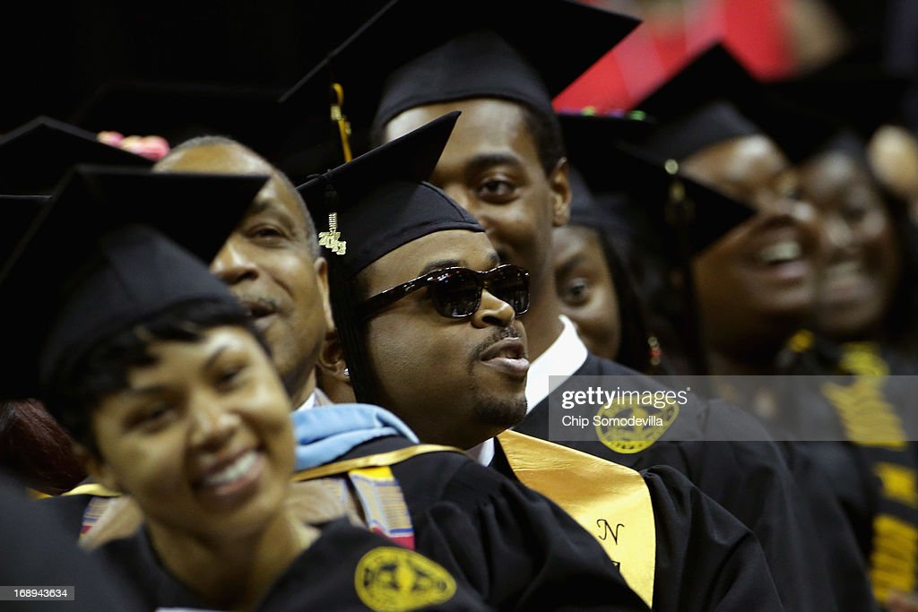 Graduates cheer as First lady Michelle Obama delivers the commencement speech during the Bowie State University graduation ceremony at the Comcast Center on the campus of the University of Maryland May 17, 2013 in College Park, Maryland. Obama received and Honorary Doctor of Laws degree before addressing the 600 graduates of Maryland's oldest historically black university and one of the ten oldest in the country.