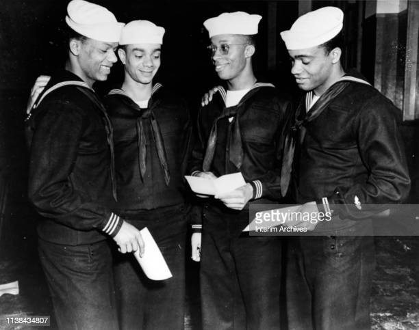 Graduates congratulate each other after ceremonies for the sixth class of the Negro Service School at the Naval Training Station in Great Lakes...