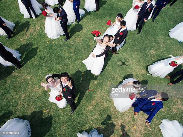 Graduates couples attend the group wedding at Zhejiang University on April 30 2016 in Hangzhou Zhejiang Province of China Over 400 couples of...