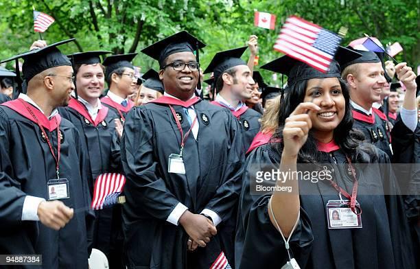 Graduates from the Harvard Business School MBA program wave flags at Harvard University Commencement in Cambridge Massachusetts US on June 5 2008 JK...