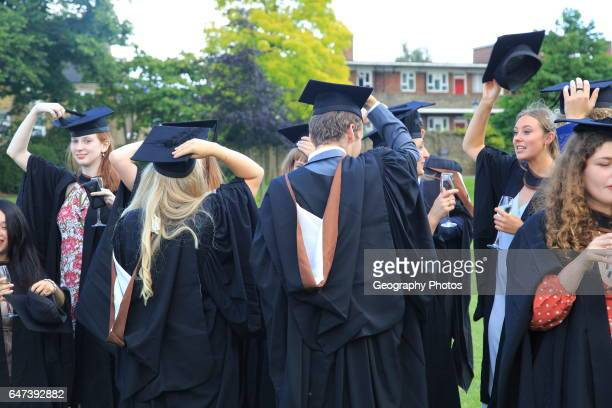 Graduates in gowns holding their mortarboards Goldsmiths University of London England UK