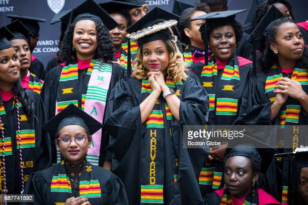 Graduates listen to the master of ceremony as they take part in the Black Commencement at Harvard University in Cambridge MA on May 23 2017 170...