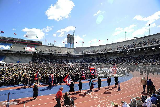 Graduates march into the University of Pennsylvania's 260th Commencement at Franklin Field on May 16 2016 in Philadelphia Pennsylvania