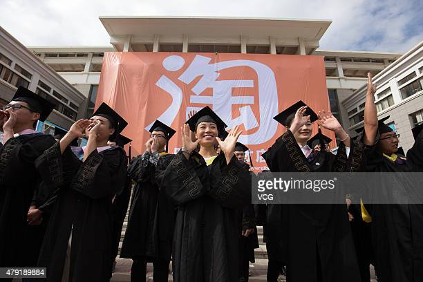 Graduates of Kunming University celebrate the opening activity of their online store for 'selling' graduates during a graduation ceremony on July 2...