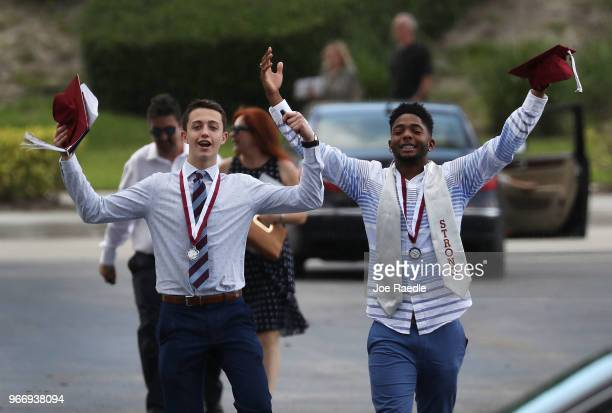 Graduates of Marjory Stoneman Douglas High School are seen as they head to their cars after attending their graduation ceremony at the BBT Center on...