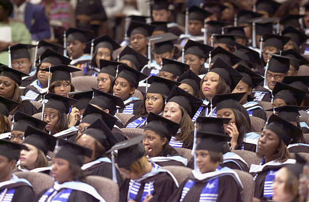Graduates of Spelman College listen to actor Danny Glover during commencement ceremonies for the womens'' school May 19 2002 in Lithonia GA...