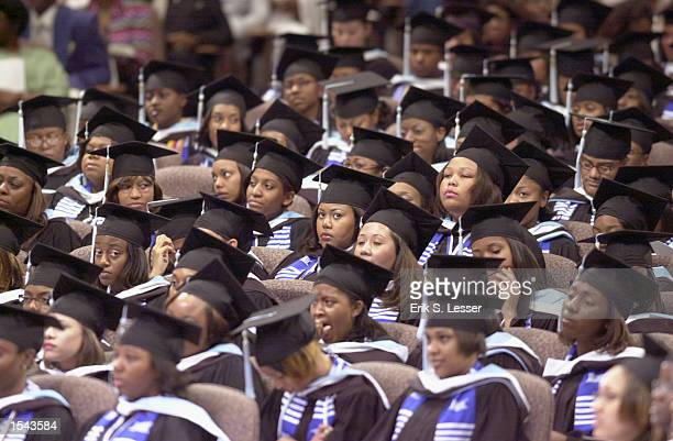 Graduates of Spelman College listen to actor Danny Glover during commencement ceremonies for the womens'' school May 19, 2002 in Lithonia, GA....