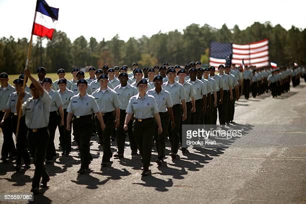 Graduates parade march past President Bush at the Basic Combat Training graduation ceremony at Fort Jackson in South Carolina