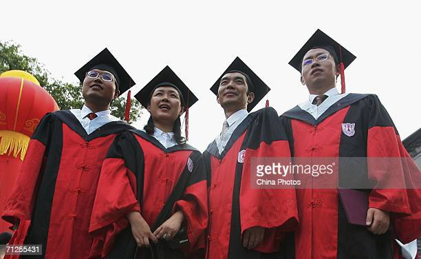 Graduates pose for pictures during a graduation ceremony at the Nanjing University on June 20 2006 in Nanjing of Jiangsu Province China China will...