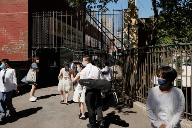 NY: New York City Public Elementary School Holds Graduation Ceremony