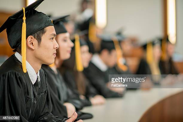 Graduates Sitting in Lecture Hall