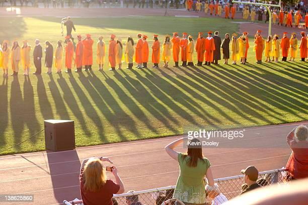 Graduates standing in ground
