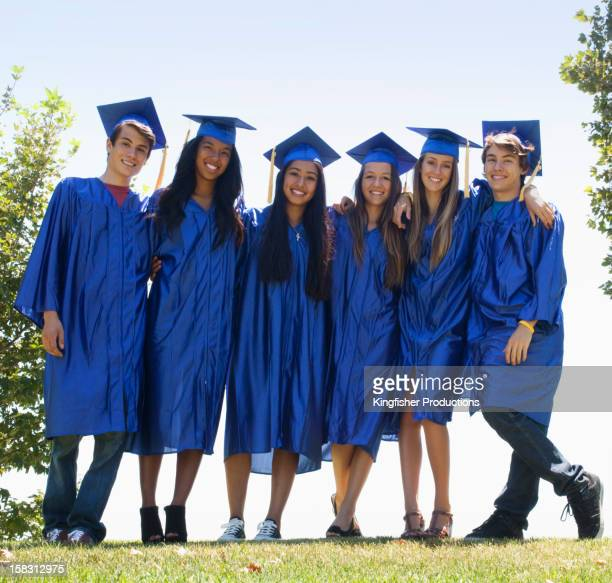 Graduates standing together