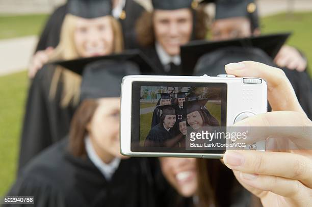 Graduates taking a self-portrait
