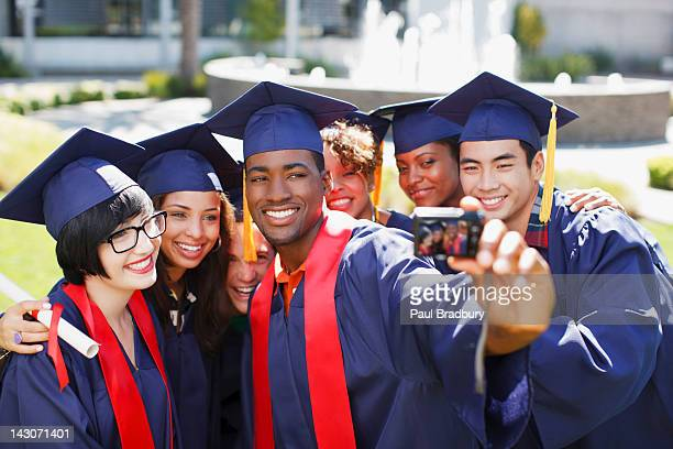 Graduates taking picture of themselves