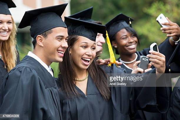 graduates taking self-portrait together outdoors - free images for educational use stock pictures, royalty-free photos & images
