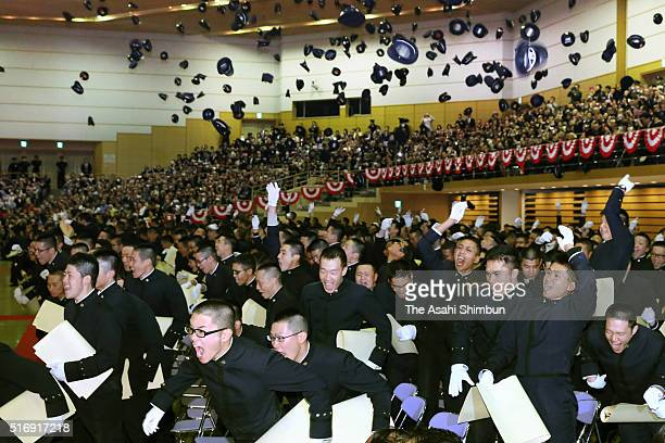 Graduates throw their caps after the National Defense Academy guaruation ceremony on March 21 2016 in Yokosuka Kanagawa Japan Prime Minister Shinzo...