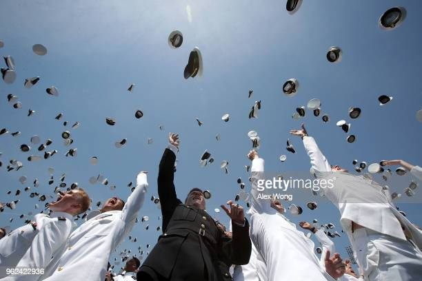 Graduates toss their caps during a graduation ceremony at the NavyMarine Corps Memorial Stadium of the US Naval Academy May 25 2018 in Annapolis...