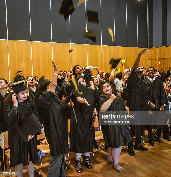Graduates toss their mortar board caps into the air as the Montgomery branch of the Latin American Youth Center the DC nonprofit holds its graduation...