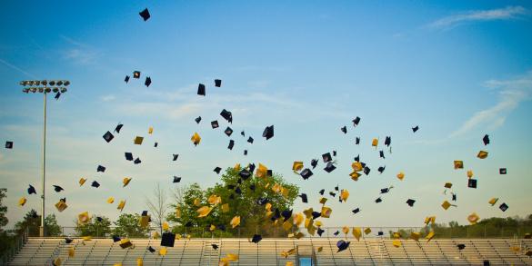 Graduates tossing mortar boards in air - gettyimageskorea