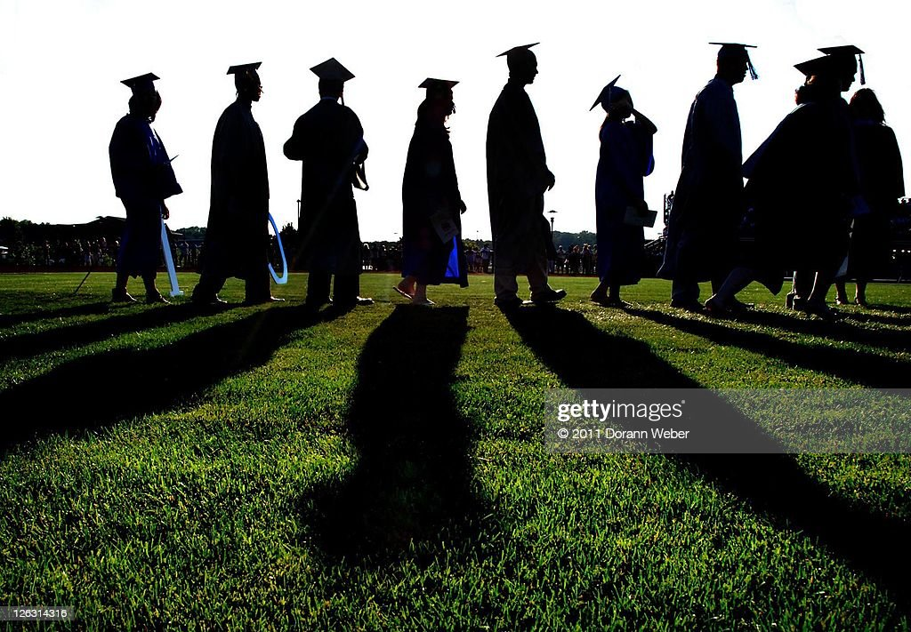 Graduates walking towards future : Stock Photo