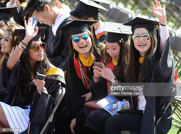 Graduates wave to family during the University of Pennsylvania's 260th Commencement at Franklin Field on May 16 2016 in Philadelphia Pennsylvania