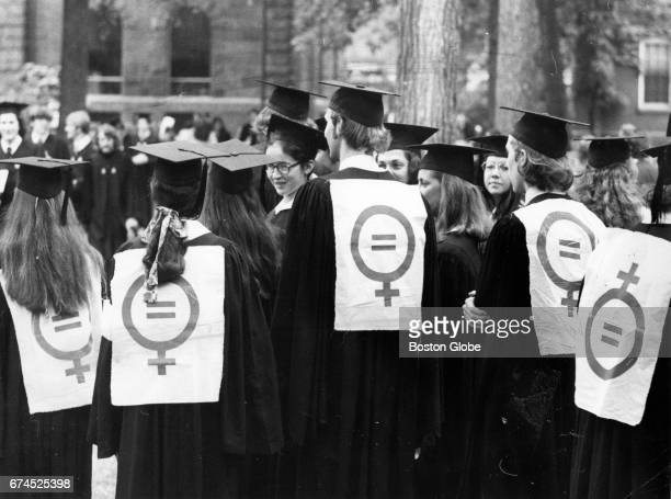 Graduates wear women's liberation signs during the 1972 Harvard University commencement in Cambridge MA on Jun 15 1972