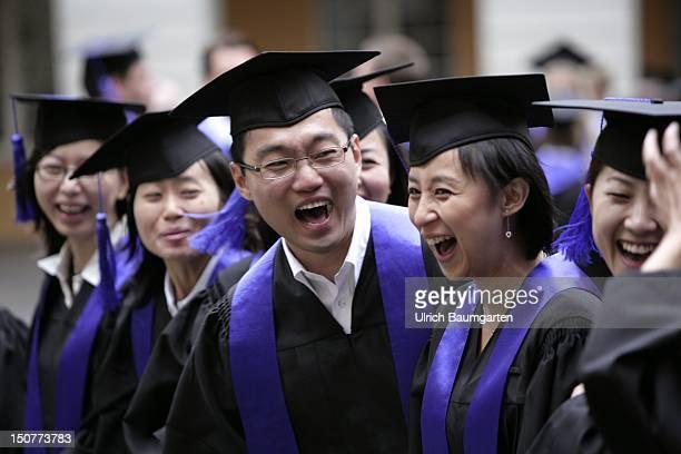 GERMANY BONN Graduates with academic gown and birettas during graduation ceremony at the Rheinische FriedrichWilhelmsUniversity Bonn Ops Chineseborn...