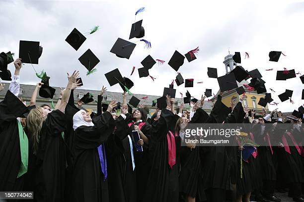 GERMANY BONN Graduates with academic gown and birettas during graduation ceremony at the Rheinische FriedrichWilhelmsUniversity Bonn Ops After the...