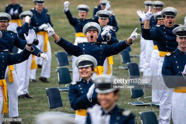 Graduating Air Force Academy cadets cheer for their parents who were not allowed to attend the ceremony due to the coronavirus pandemic on April 18...