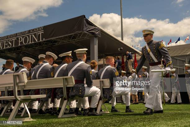 Graduating cadet walks with his diploma as he is congratulated by a classmate during graduation ceremony of the U.S. Military Academy Class of 2019...